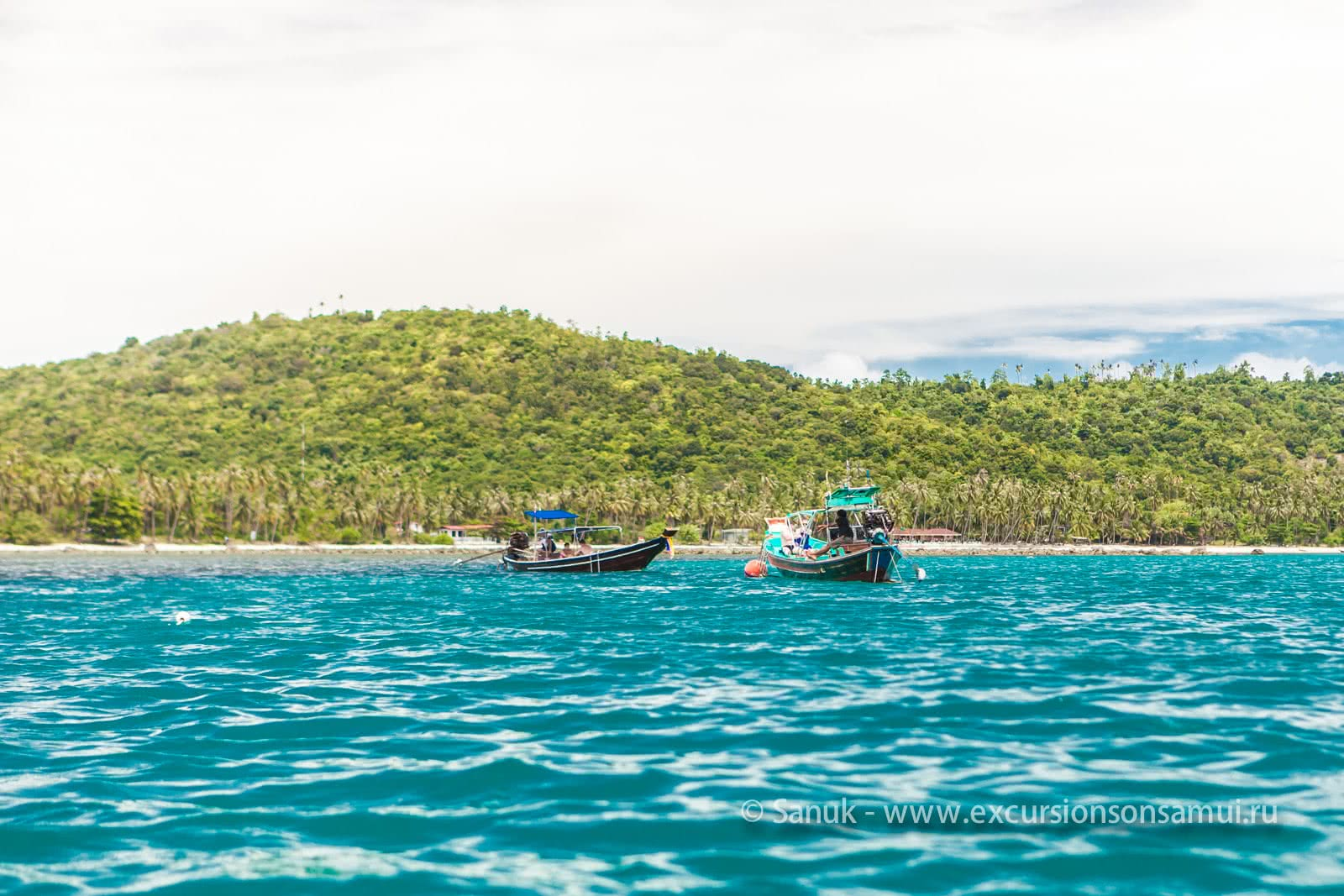 Snorkeling and fishing in the waters of Koh Tan, Koh Samui, Thailand